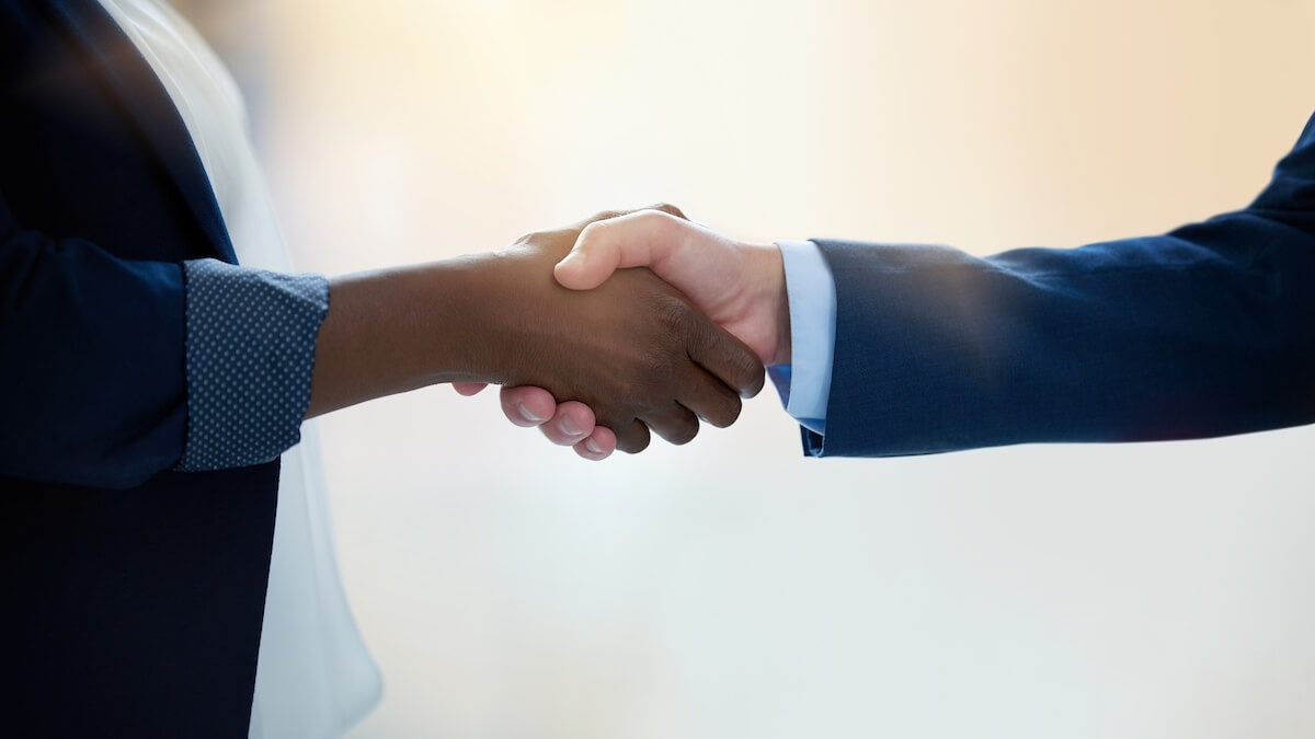 A Business Handshake, Representing an Authentic Connection via Outsourced IT Support