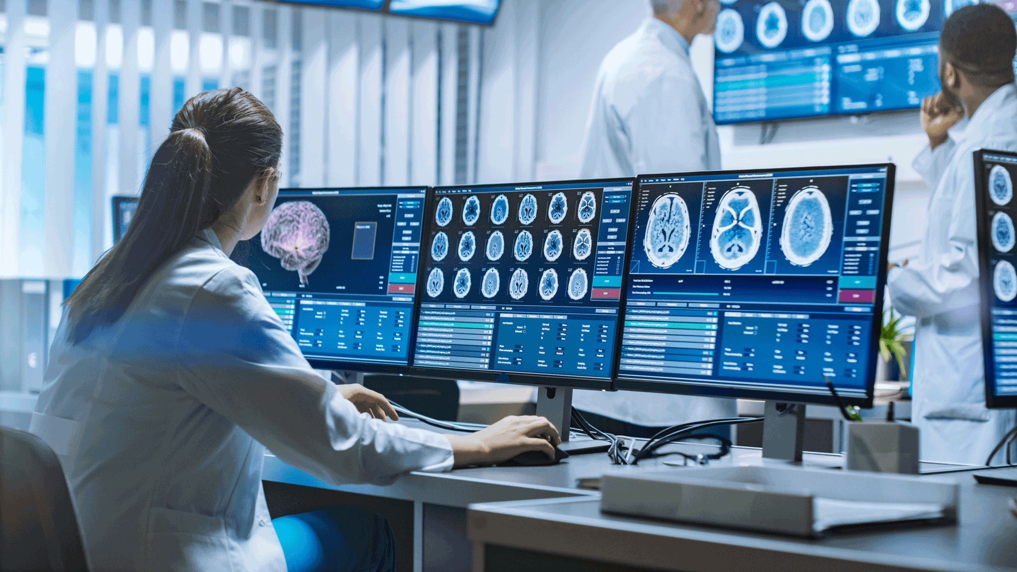 Radiologist Reviewing Shared PACS Data Across Multiple Screens