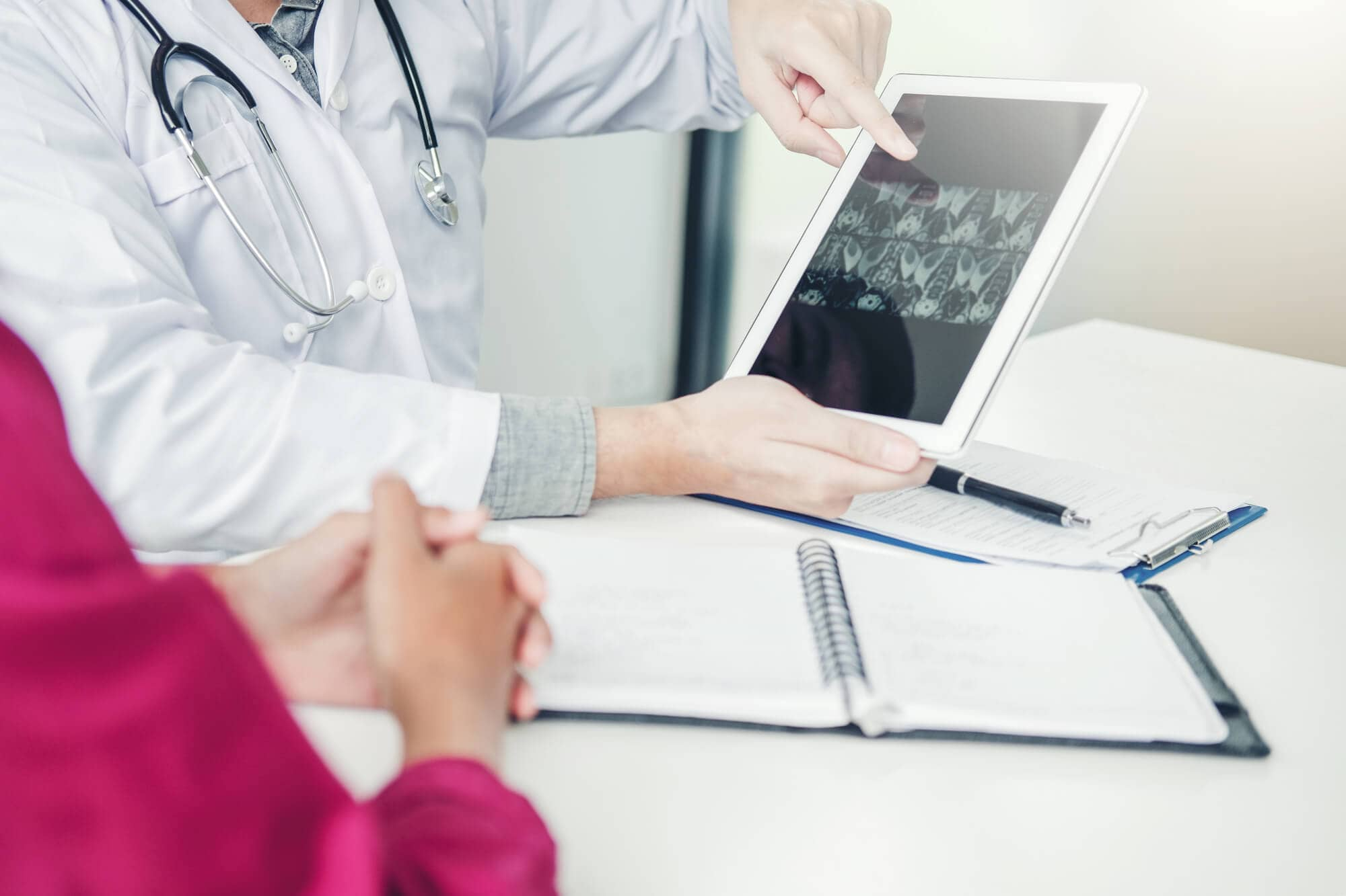 Doctors Imaging-Enabled Physician Reviewing Patient's Records via Secure Web Portal